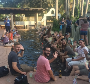 Participants from the 2018 Dream Big Summit enjoy their time with colleagues as they dip their feet in a Quinta Mazatlan pool!